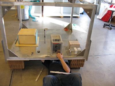 Team member Mark Fittock installs the experiment onto the gondola